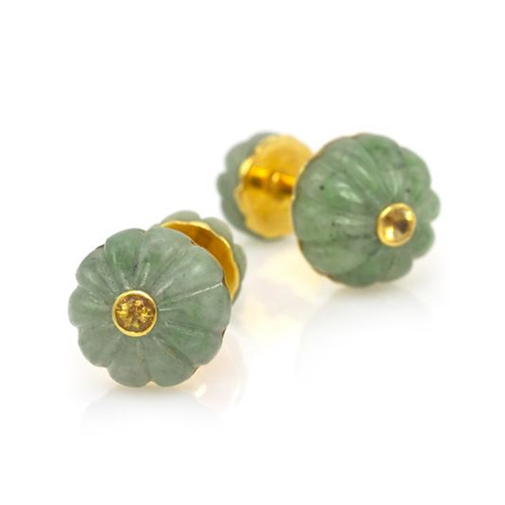 A Pair of Jade and Yellow Sapphire Cufflinks, by Cartier