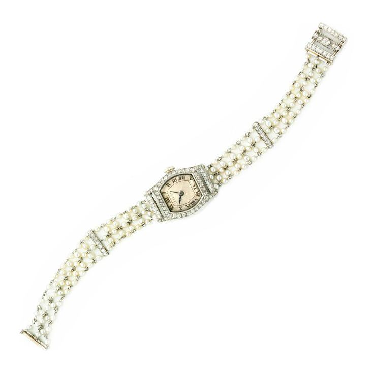 An Art Deco Seed Pearl and Diamond Wristwatch, by Cartier, circa 1920