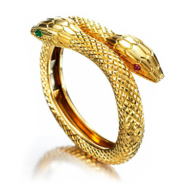 An Emerald, Ruby and Gold Bracelet, by Cartier