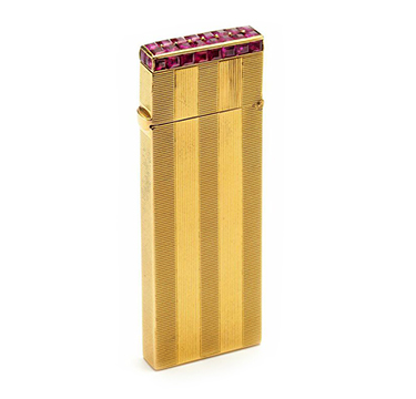A Ruby and Gold Lighter, by Van Cleef & Arpels