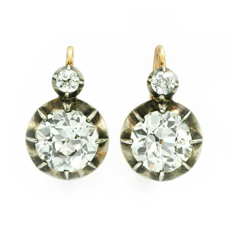 A Pair of Old European-cut Diamond Ear Pendants, of 2.20 and 2.29 carats, mounted in silver and gold