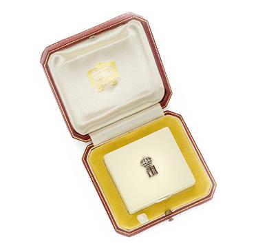 An Art Deco White Enamel, Ruby, Platinum and Silver Vanity Case, circa 1925