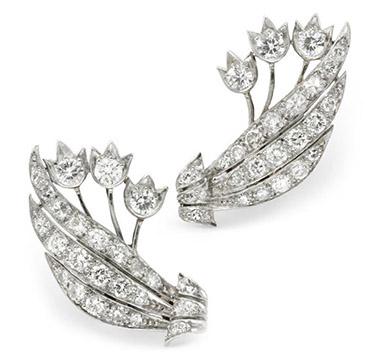 A Pair of Diamond and Platinum Flower Ear Clips, circa 1940