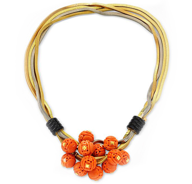 A Carved Coral, Onyx and Tri-colored Gold Necklace, by Cartier, circa 1937