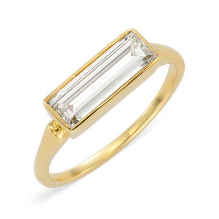 A Baguette-cut Diamond and Gold ring, of 1.35 carats