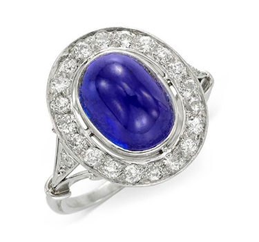 An Art Deco Ceylon Cabochon Sapphire And Diamond Ring, Circa 1920