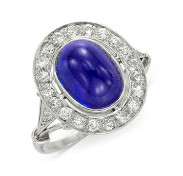 An Art Deco Ceylon Cabochon Sapphire and Diamond Ring, circa 1920