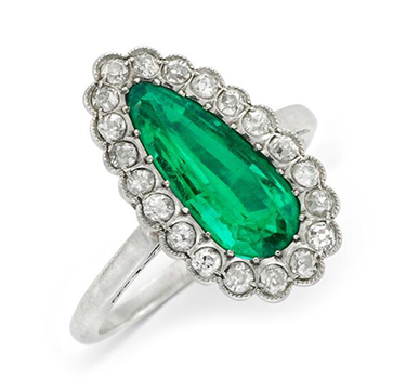 A Pear-shaped Emerald and Diamond Ring