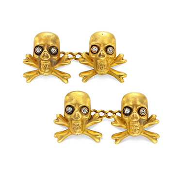 A Pair of Gold and Diamond Skull and Cross bone Cufflinks