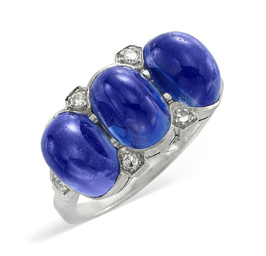 An Early 20th Century Cabochon Sapphire and Diamond Three Stone Ring