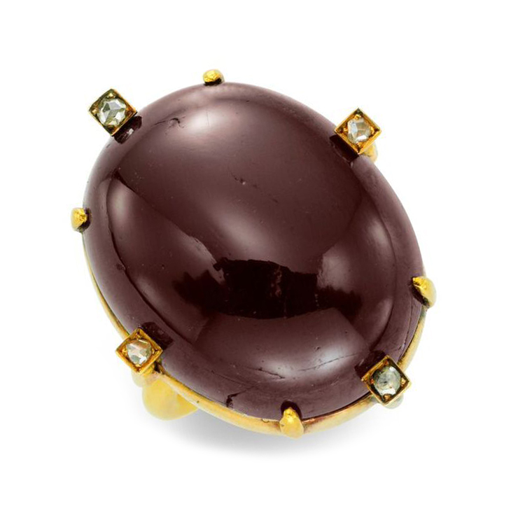 A Cabochon Garnet and Rose-cut Diamond Ring