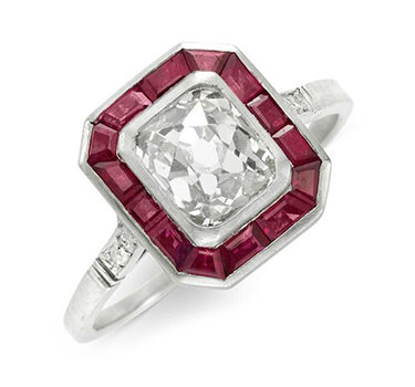 An Art Deco French-cut Diamond Ring, Set Within A Border Of Calibre-cut Rubies, Circa 1920