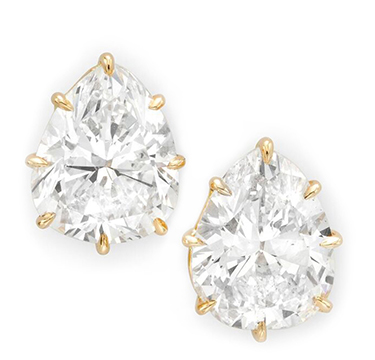 A Pair of Pear-shaped Diamond Stud Earrings, weighing 4.23 and 4.44 carats