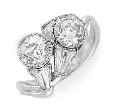 An Art Deco Diamond Ring, centering on a pair of Old European-cut Diamonds