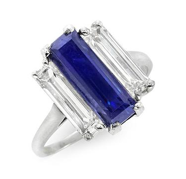A Three Stone Sapphire and Diamond Ring