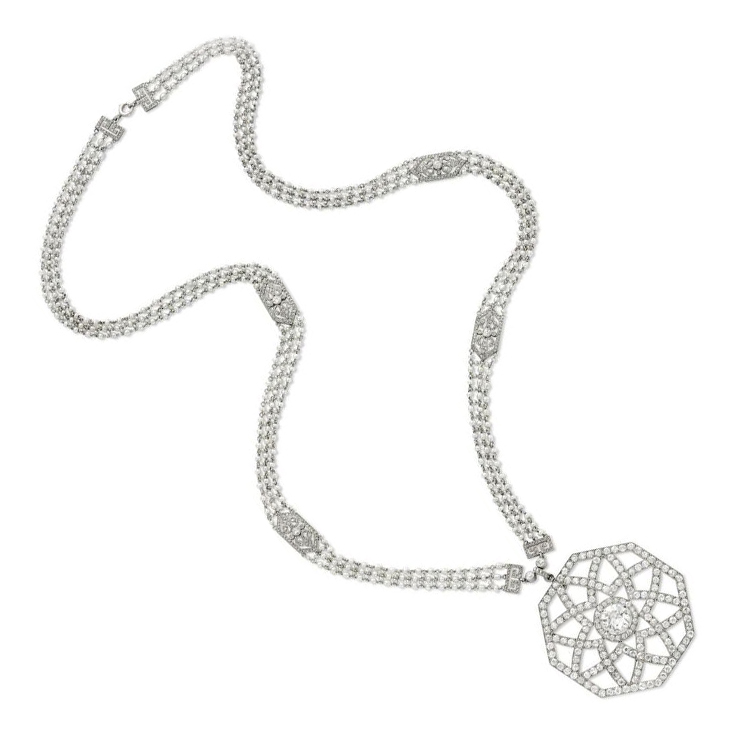 An Edwardian Diamond and Seed Pearl Pendant Necklace, by Cartier, circa 1910
