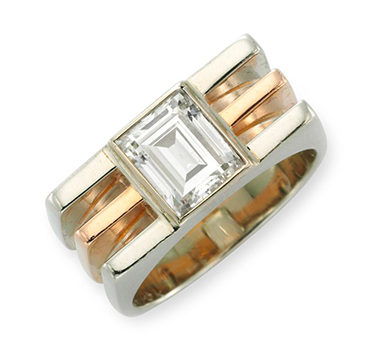 A Diamond And Bi-colored Gold Ring, In The Machinist Style, Centering Upon A Rectangular-cut Diamond