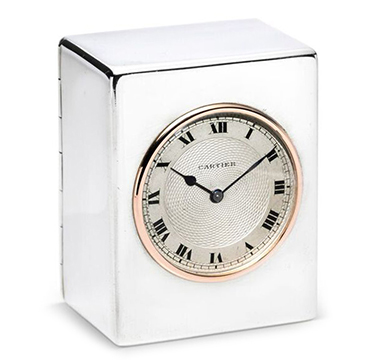 A Sterling Silver and Gold Clock, by Cartier, circa 1930