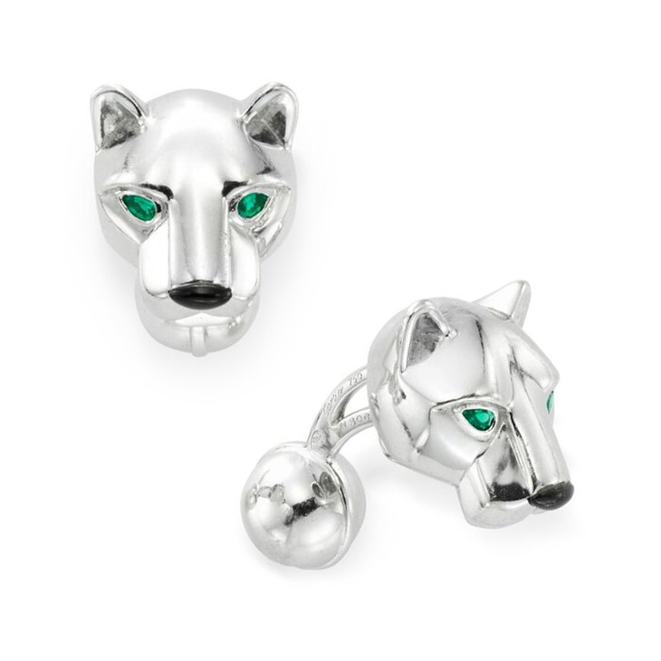 A Pair of Emerald, Onyx and White Gold Panther Cufflinks, by Cartier