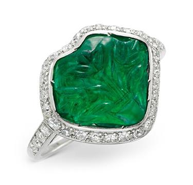 An Art Deco Carved Emerald, Diamond and Black Enamel Ring, circa 1925