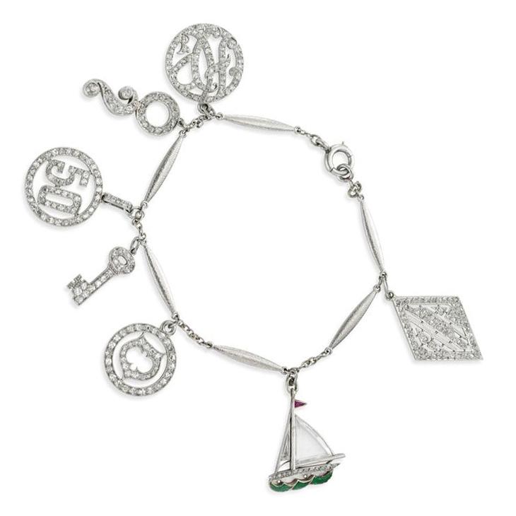 An Art Deco Diamond and Platinum Charm Bracelet, circa 1925