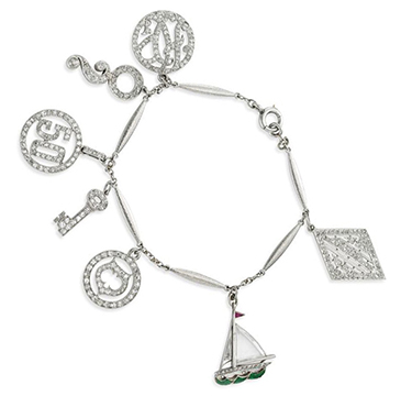 An Art Deco Diamond and Platinum Charm Bracelet, circa 1925