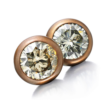 A Pair of Fancy Colored Diamond Stud Earrings, of 10.22 and 10.45 carats, set in copper and gold, by Hemmerle
