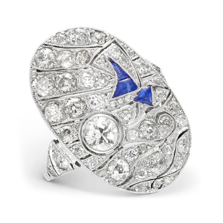 An Art Deco Sapphire and Diamond 'Sailing Scene' Plaque Ring, circa 1930