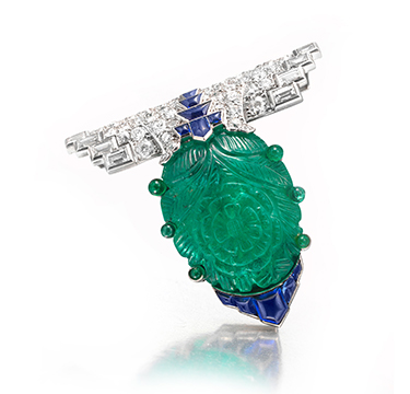 An Important Art Deco Carved Emerald, Sapphire and Diamond Clip Brooch, by Cartier, circa 1925