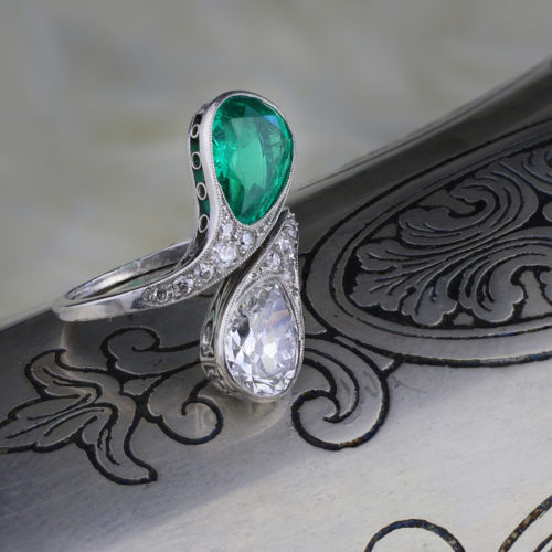 An Early 20th Century Emerald and Diamond Bypass Ring