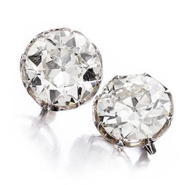 A Pair of Old European-cut Diamond Ear Studs, weighing 8.78 and 9.61 carats