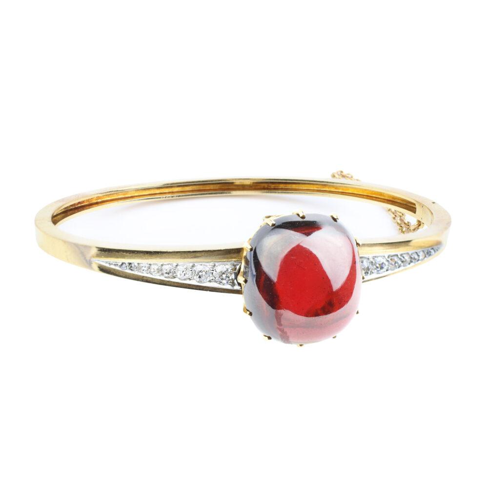 A Gold, Cabochon Garnet and Diamond Bangle Bracelet