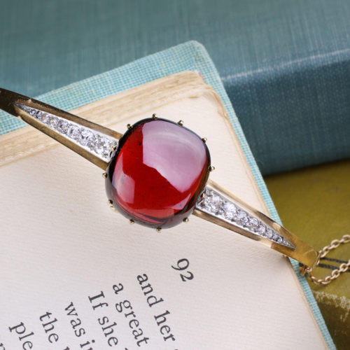 A Gold, Cabochon Garnet and Diamond Bangle Bracelet