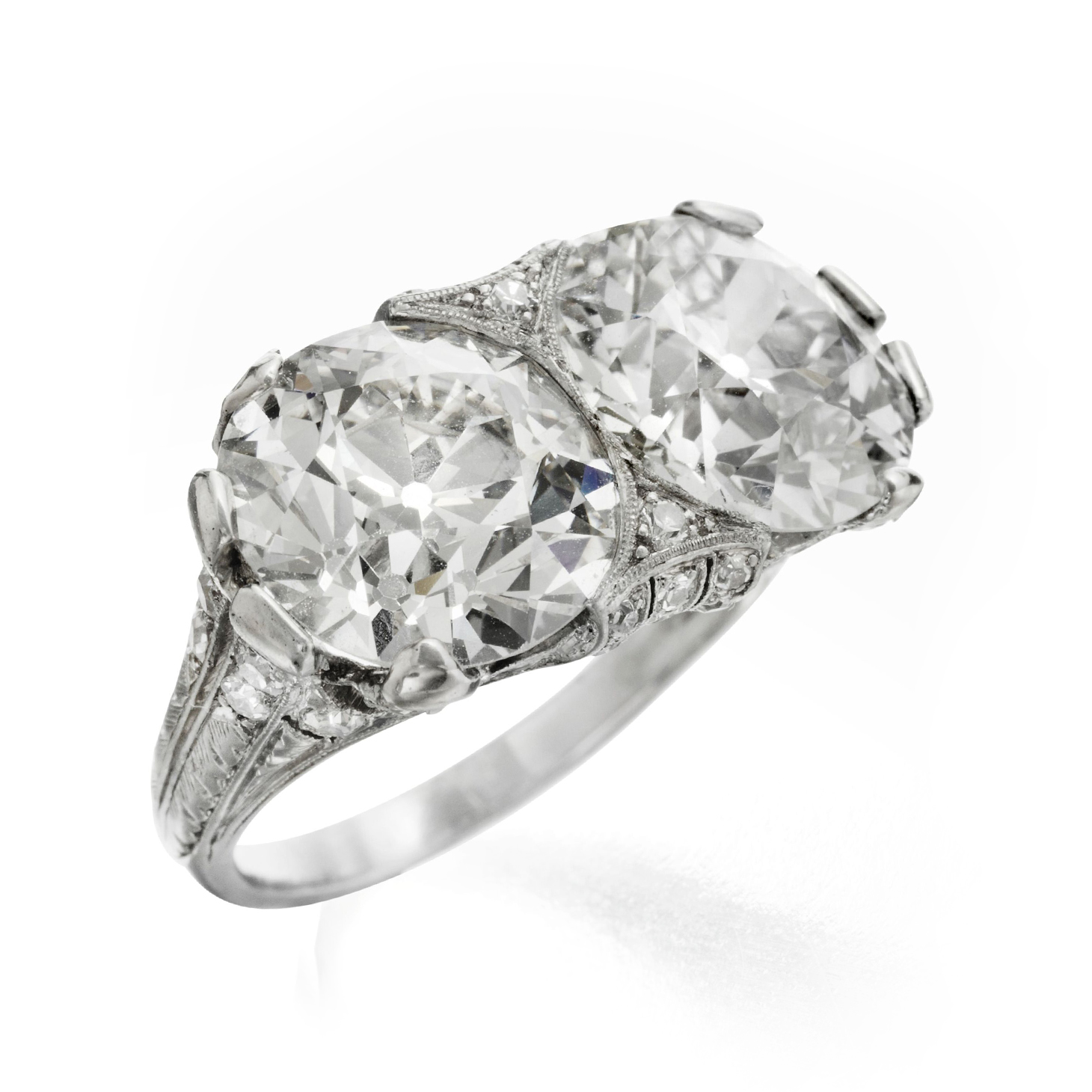 An Early 20th Century Diamond Twin Ring, set with old European-cut diamonds, weighing 4.78 and 4.56 carats