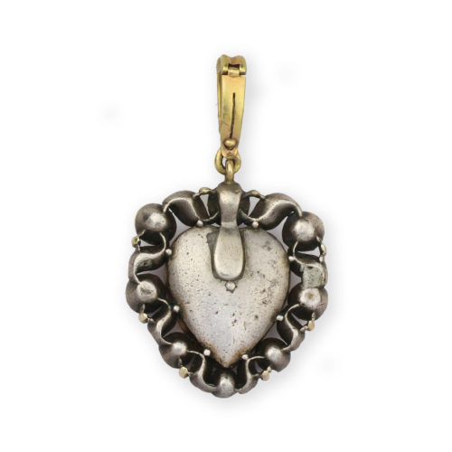 A Rock Crystal, Ruby and Diamond Heart Pendant