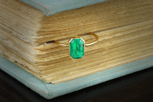 Cut Cornered Rectangular Shaped Emerald And Gold Ring