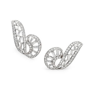 A Pair of Art Deco Scrolling Diamond Ear Clips, by Cartier, circa 1930