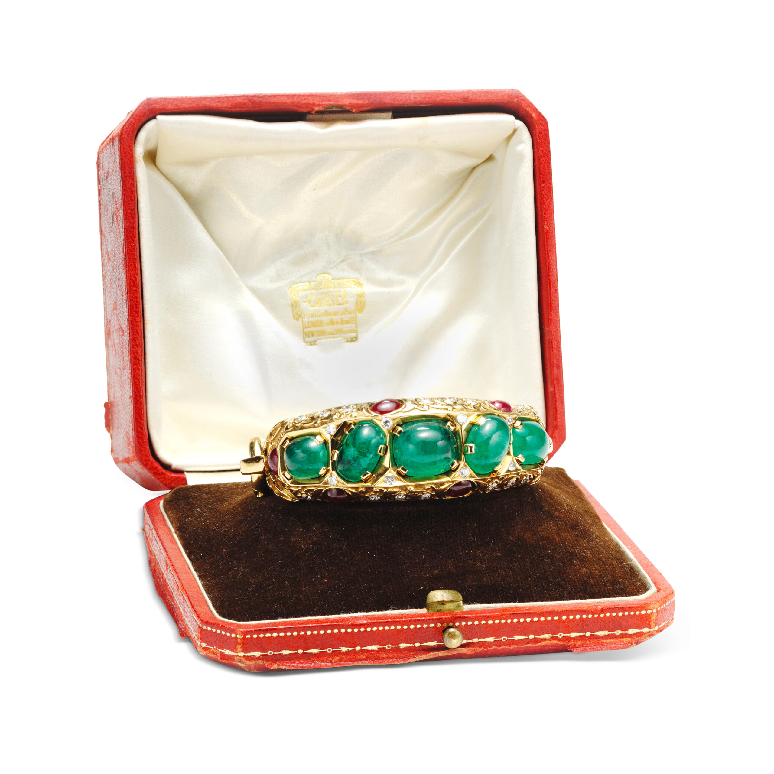 An Emerald, Ruby and Diamond Bangle Bracelet, by Cartier, made in 1945