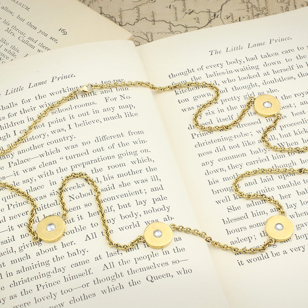 A Gold and Diamond Disc Necklace