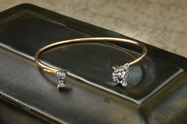 A Silver, Gold And Diamond Bangle Bracelet