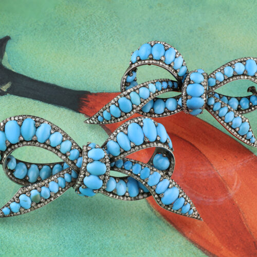 A Pair of Antique Turquoise and Diamond Set Brooches