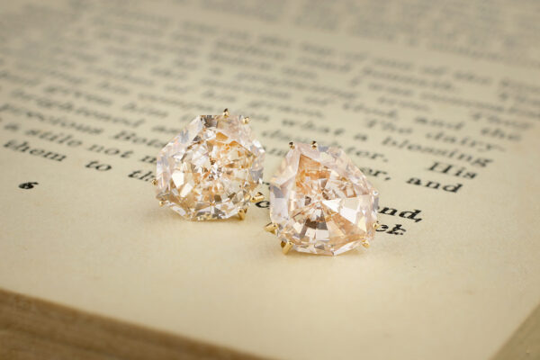 A Pair Of Colored Diamond Stud Earrings