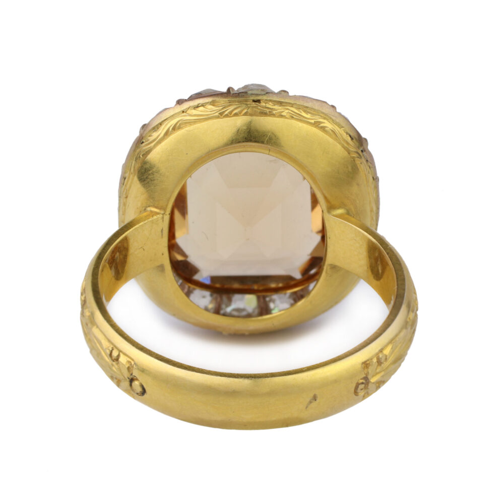 An Imperial Topaz and Diamond Ring