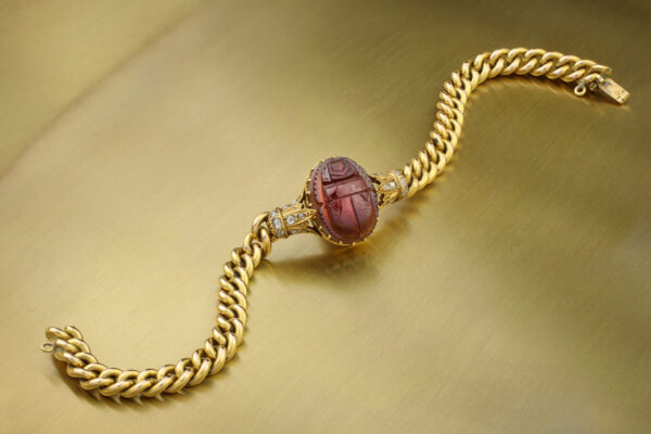 An Egyptian Revival Gold, Diamond And Carved Garnet Scarab Bracelet