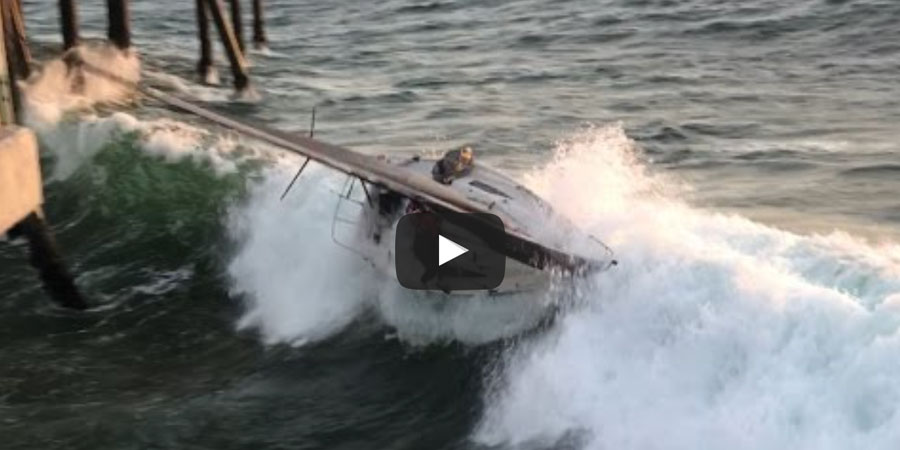 Photo of Sailboat Capsized Into Redondo Pier. VIDEO