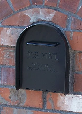 Image of a heavy duty metal mailbox insert in a brick mail box.