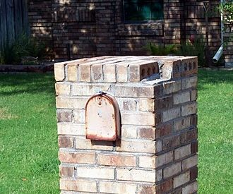Brick Mailbox looking disheveled because of loose and deteriorated brick.