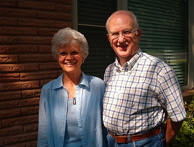 """Alvin and Ellen Jennings of Hurst recently celebrated their 50th wedding anniversary. Here, they are grinning about their special """"Parents of the Owner"""" discount thy received on their brick repairs."""