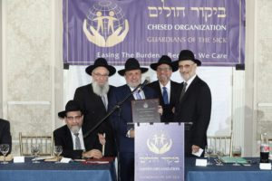 Saul N. Friedman accepting the Shearis HaPleitah Award in honor of his mother, Babi Henchu.  (L-R) R' Yisroel Herskovits, Saul N. Friedman, R' Avi Fishof, R' Chaim Dovid Zwiebel.