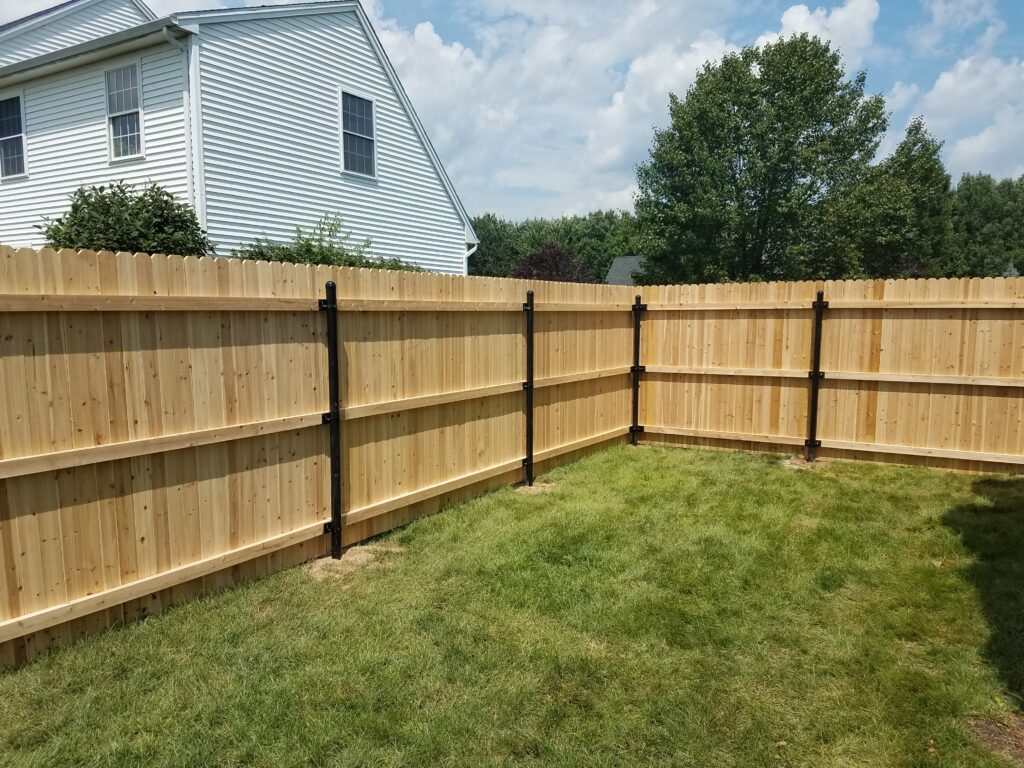 Cedar Stockade with Steel Posts